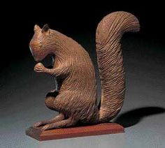Squirrel Eating Nut / Attributed to Henry Leach (1809–1885) / Boston / 1869–1870 / Pine / 16 1/4 x 16 3/4 x 17 1/2 in. / American Folk Art Museum, promised gift of Ralph Esmerian, P1.2001.331