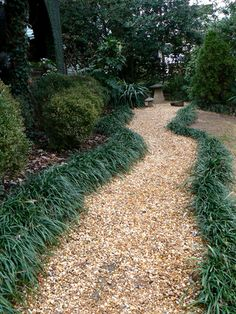 A pea gravel walkway around the entire perimeter of our property, with smaller paths leading to special places, is in my plans!