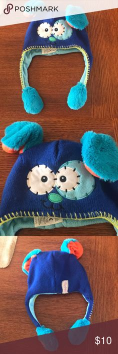 """Kids """"one size"""" blue dog Flipeez hat Kids Flipeez hat, dark blue and light blue with a dog face and ears. You squeeze it and the ears pop up. The ears have some orange on them, and the back Flipeez label is gray. Flipeez Accessories Hats"""