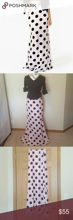 Nasty Gal Chiffon Polka Dot Chill Spot Maxi Skirt Nasty Gal brand in a size Small. The chill spot maxi skirt is a light pink color with black polka dot. The skirt has a chiffon skirt thst is partially lined (with a shorter underskirt) and zips in the back. It is high waisted and a slightly flared fit. The zipper has professionally repaired so it works perfectly. Smoke free home and fast shipping. I do offer bundle deals as well. Thank you for checking out my closet. Nasty Gal Skirts