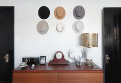 The hats hanging in the bedroom work as interesting decor, and also offer a storage solution.