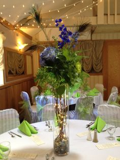 Template a lighted example (table centerpiece with peacock feathers, blue hydrangea, and blue delphinium in large glass cylinder vase with lighted branches) Wedding Table Centerpieces, Wedding Reception Decorations, Burlap Centerpieces, Wedding Ideas, Prom Ideas, Reception Table, Wedding Bells, Wedding Planning, Peacock Wedding