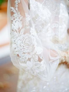 Claire Pettibone wedding dress Ariel with embroidered long sleeves.