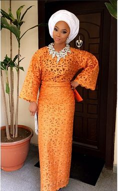 Orange Nigerian weddings. White gele. Top skirt/dress. Bride inspiration. aso oke. white bead necklace