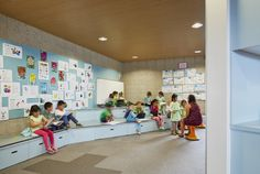 great storage in sitting area - St Mary of the Cross Primary School in Australia / Baldasso Cortese Architects