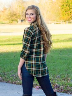 Piece of Plaid Top   DazyLu. We are mad for plaid this fall and our Piece of Plaid Top is amazing! This pull over top with buttons has a v-neck and rolled 3/4 length sleeves.  This plaid top features green, black, yellow, and a touch of brown.