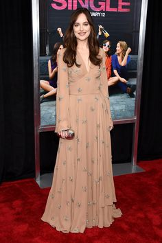 Dakota Johnson.. Saint Laurent Fall 2015 gown, and Judith Leiber Partbead Ribbed Soapdish Clutch..
