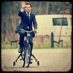 People riding bikes definitely  symbolize the Netherlands, especially when the prime minister does it.