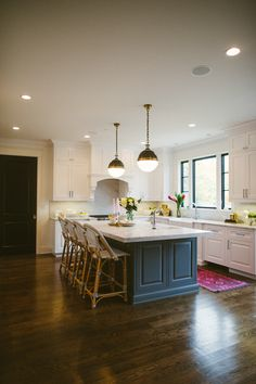 looks warm. love the floors, counter tops, island, cabinets, above range hood. So homey.