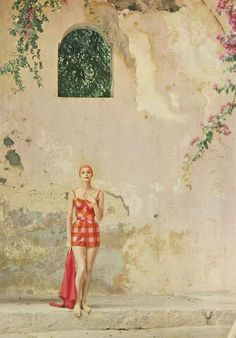 https://flic.kr/p/9rgxvQ | January Vogue 1959 | Wearing a cotton satin swimsuit in pinks and reds, by Cole of California. Photographed by husband, Tom Palumbo.