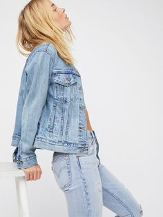 Ex-Boyfriend Trucker Denim Jacket | For a borrowed-from-the-boys look, this Trucker jacket from Levi's is featured in a bigger, longer, and looser silhouette from their classic boyfriend fit.    * Relaxed, oversized fit   * Non-stretch ridged denim   * Waist pockets and double breast pockets    * Adjustable side tabs