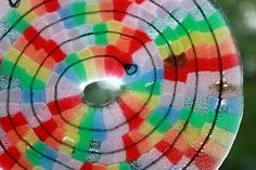 Melted string of beads into spiral suncatcher