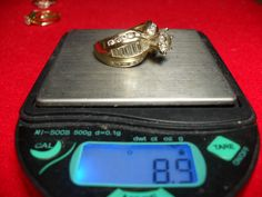 USED 14KT AND DIAMOND WEDDING RING - LARGER RING SIZE. $29,999 OR BEST OFFER.