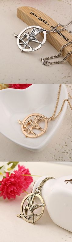 The Hunger Games Necklace! Click The Image To Buy It Now or Tag Someone You Want To Buy This For.  #HungerGames