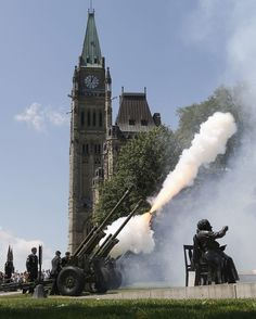 Members of the 30th Field Regiment of the Royal Canadian Artillery fire a 21-gun Royal Salute on Parliament Hill.