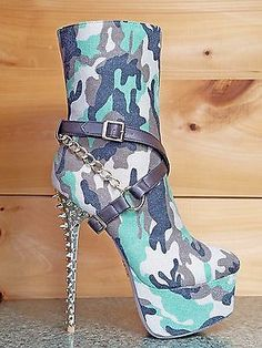 Camo Canvas UpperStrap, chain Buckle AccentsPadded insole & round toe front,Gold spiked detailed heel with a platform bottomSide Zipper for closure. Shoes Boots Ankle, High Heel Boots, Heeled Boots, Camo Boots, Platform High Heels, Platform Boots, Nylons, Hot Heels, Spike Heels
