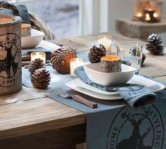 Voor een stoere kerst: tafelloper en servies met dennenappels als extra decoratie #x-mas