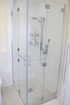Bi-folding shower doors.