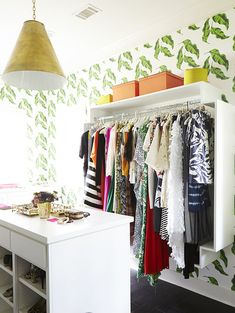 Bohemian Contemporary Closet: Clothing rack and other storage in bright  walled room..