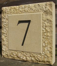hand carved stone house number