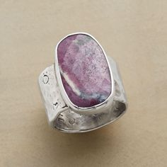 PRAIRIE ROSE RING. Jes MaHarry captures the wild beauty of raw ruby in a wide sterling silver ring, hand-hammered and bearing a hidden heart on back.