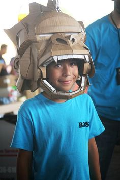 "Cardboard mask. Caine sports a cardboard gorilla mask made by artist John Park. John will be teaching a cardboard mask making workshop at our Oct 5th Caine's Arcade East LA ""Day of Play"" Cardboard Challenge (at Hollenbeck Middle School)"