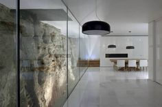 Barud House by Paritzki Liani Architects - embedded in Jerusalem stone.
