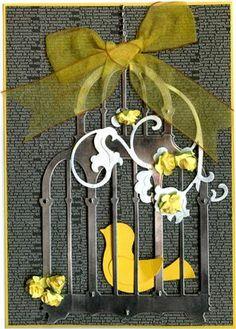 X-Cut Detailed Dies - Birdcage 3, Memory Box Madeleine Bird, Sizzix thinlits butterflies and flower vine, BasicGrey Bow Ties Freezer tag paper.