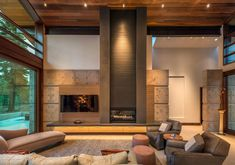 Concrete And Wooden Wall Panel Also Vertical Gray Panel With Fireplace And Spotlights Decorating The Large Living Room With Modern Sofa And Lounge Chairs Also Lovely Daybed Modern country house with a curved roof in California Home design