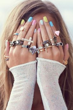 Pastel nails and pretty ring stacks.