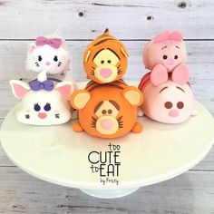 Tsum Tsum Rice Krispy Treats covered in fondant cake toppers with their tsum tsum soft toys model - Marie, Tigger, Pigglet