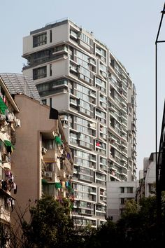 Photography: Wang Shu Projects, by Clement Guillaume,Vertical Houses / © Clement Guillaume