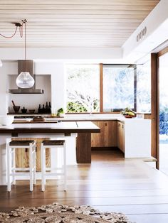 modern wood kitchen // no upper cabinets, windows in kitchen, kitchen island design