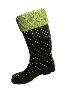 Even though you will only see that touch of knitted fashion statement that folds over the top of the boot, these toppers actually extend into the boot down to the ankle; yes a leg warmer designed specifically to be worn with rubber boots. The trellis stitch pattern is on the cuff only changing to a rib pattern for the leg warmer. Knit flat and seamed up.