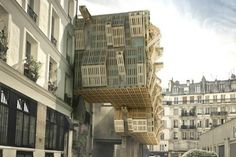 A proposal by the Paris-based studio Stephane Malka Architecture to re-skin – by using shipping pallets – the facade of an old student house. Green Architecture, Sustainable Architecture, Sustainable Design, Architecture Design, Architecture Company, Paris Architecture, Wooden Architecture, Recycled Pallets, Wooden Pallets
