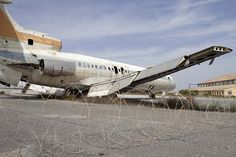 Nicosia International Airport abandoned plane by Yiannis Kourtoglou shutterstock.com