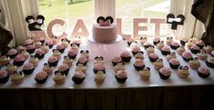 Huge cupcake display at a Minnie Mouse baby shower  party! See more party planning ideas at CatchMyParty.com!