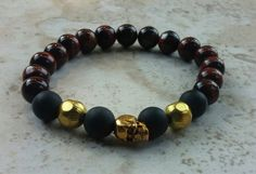 Check out this item in my Etsy shop https://www.etsy.com/listing/120446749/mens-bracelet-black-onyx-tigers-eye