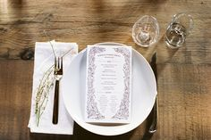"""Picnic table for a natural feel, herb sprigs for decoration, cotton napkins and glasses for a """"special"""" touch, and printed menus for your guests."""