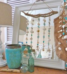 Clever~hang sea glass hanging over a mirror! I own the big blue vase ; )