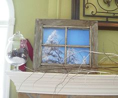 photo picture of  old frame with trees outside in snow, white winter