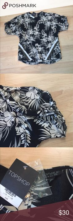 Topshop Floral Cold Shoulder Top Sz 6/Small Brand new with tags!  Ultra cool oversized Topshop cold shoulder top in a fun Floral print.  Silky material bio is machine washable.  US size 6 or small but is meant to fit loosely.  Button at the back of the neck to change up the fit. Topshop Tops Blouses