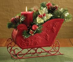 """46 Unique Sleigh Decor Ideas For Christmas Fun Christmas decorations can make your home a vibrant addition to the neighborhood without appearing """"tacky"""". Christmas Flower Arrangements, Christmas Flowers, Christmas Table Decorations, Centerpiece Decorations, Table Centerpieces, Christmas Sled, Christmas Projects, Christmas Sleighs, Silver Christmas"""