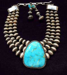 Triple strand  Navajo Pearls with Kingman Turquoise set w/ matching earrings.