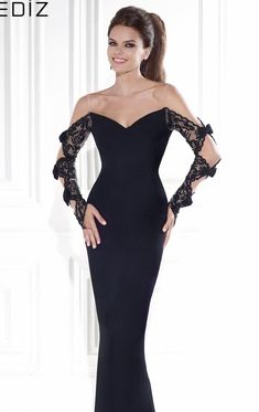 Get the look of the celebrity in Tarik Ediz 92571. This graceful evening gown features a wide v-neckline and v-open back. Splendid lace adorns the sheer fabric that wraps the full length sleeves. The fitted silhouette is trimmed with the slim full-length hem skirt with small train.