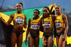 Christine Day, Rosemarie Whyte, Shericka Williams, Novlene Williams-Mills of Jamaica celebrate winning bronze in the Women's 4 x 400m Final on Day