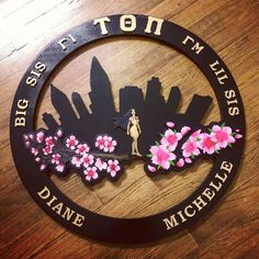 "City scape cut out top  Cherry blossoms & Pocahontas plated   #GreekLife #POCAHONTAS #greekpaddle #greekpaddles #custompaddle #custompaddles #tauthetapi #ΤΘΠ  For inquiries and orders: Message ""Dang Paddles"" on Facebook Or DangPaddles@Gmail.com"