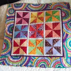 Pinwheel Circle Wall Hanging  24 inches by QuiltCupboard on Etsy, $50.00