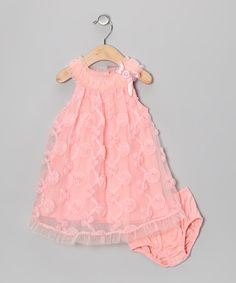 This pretty pair is ready to deck a lucky little lady out in the softest style. With enchanting cap-sleeves, frilly ruffles and a pastel hue, it's an ensemble with charm to spare. Includes dress and diaper coverDress: cotton / nylonDiaper cover: 100% cottonMachine wash; tumble dry...