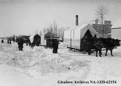 Settlers leaving immigration hall, Edmonton, Alberta c.1910 - Wood-based tents on sleds drawn by oxen. Bound for Grande Prairie and Peace River district in winter.